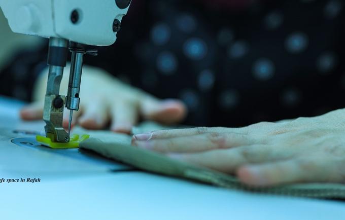Woman in Safe Space in Rafah, learning sewing